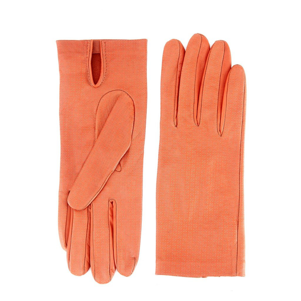 Women's unlined orange nappa leather gloves with all over laser cut detail